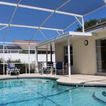 Large Heated Pool with Lounge Chairs and a Table. Plenty of Space for Entertaining